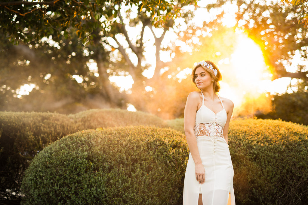 Ning Wong portrait of bride with juniper hedges and golden sunlight