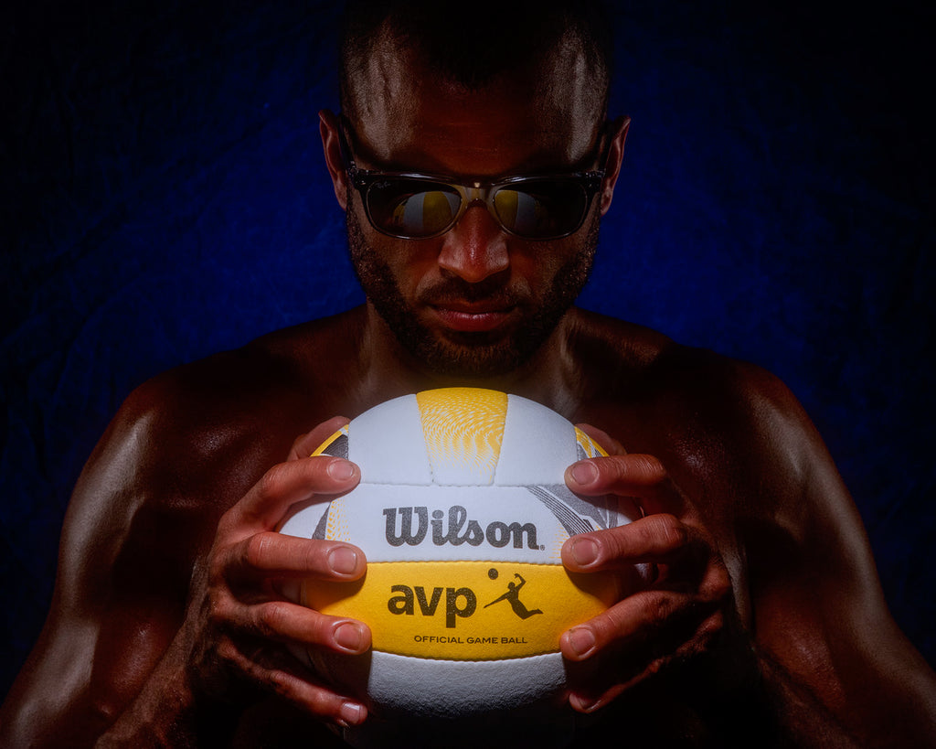 Paolo Cascio man holding volleyball in hands wearing sunglasses