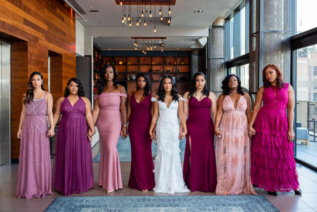 Petronella Lugemwa bride and bridesmaids walking hand in hand holding hands