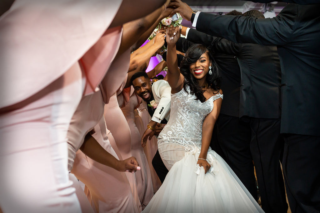 Petronella Lugemwa bride and groom dancing through human tunnel