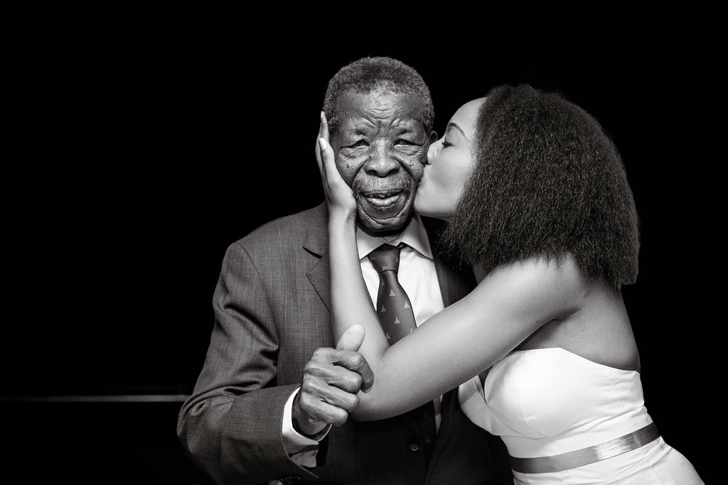 Petronella Lugemwa portrait of bride kissing father of the bride on cheek black and white