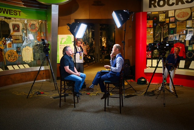 Rock and Roll hall of fame interview colorful background