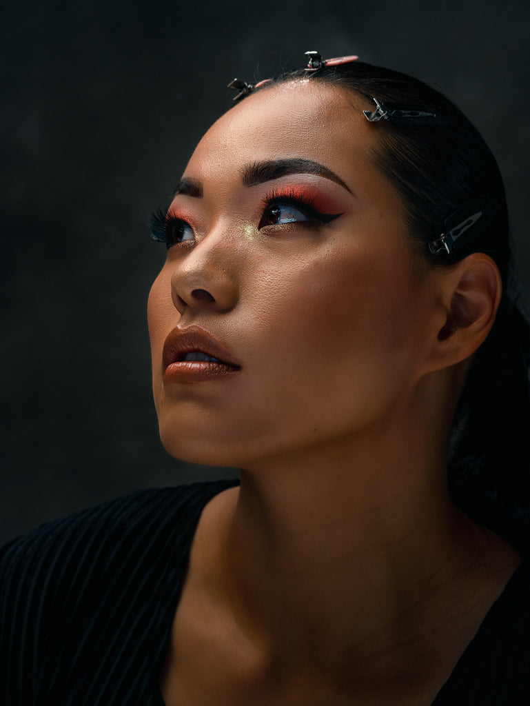 Ron Williams portrait of Asian woman with red pink makeup