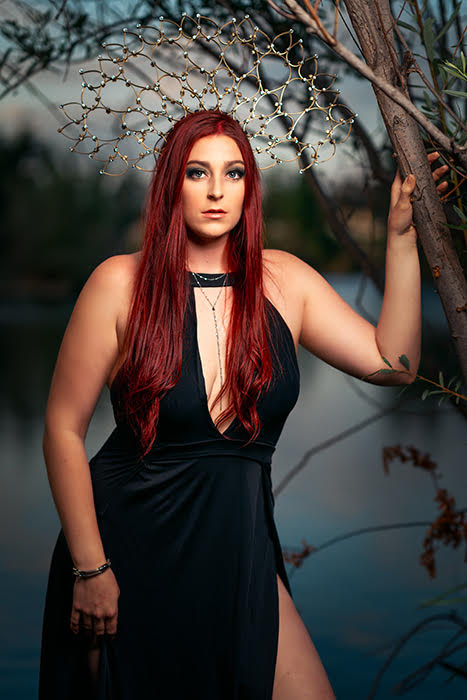 Ron Williams portrait of woman in black dress long red hair trees water