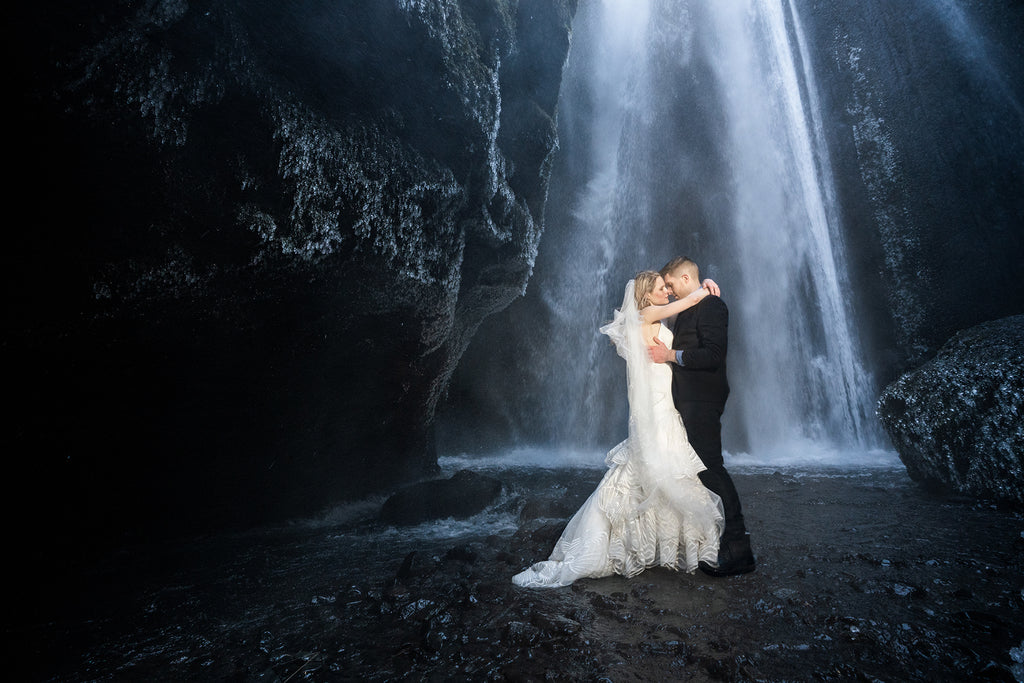 Sara France Photograph of bride and groom at rocky waterfall