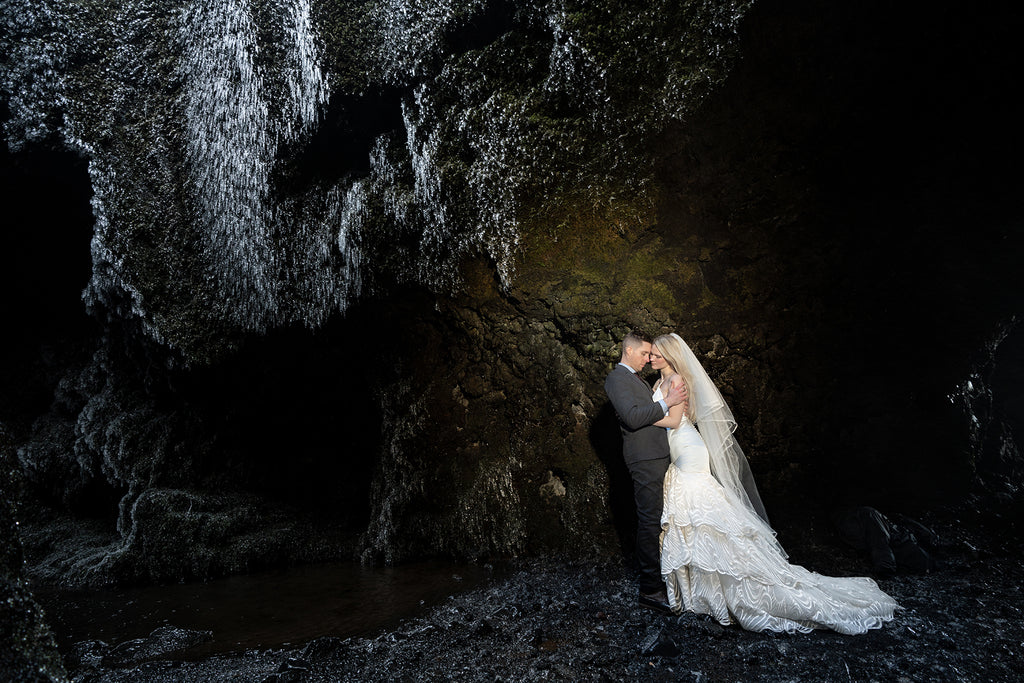 Sara France Photograph of bride and groom in ice cave