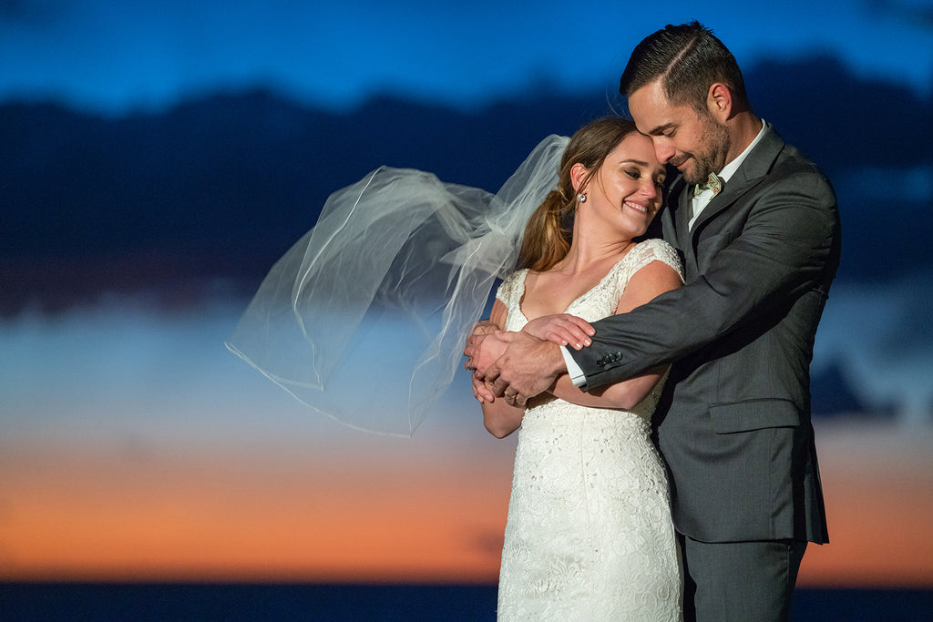 Sara France photograph of bride and groom at orange sunset clouds