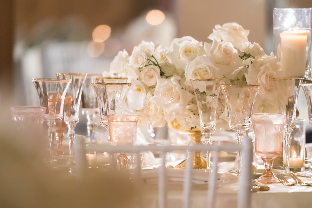Sara France photograph of wedding reception table with flowers and wine glasses white roses