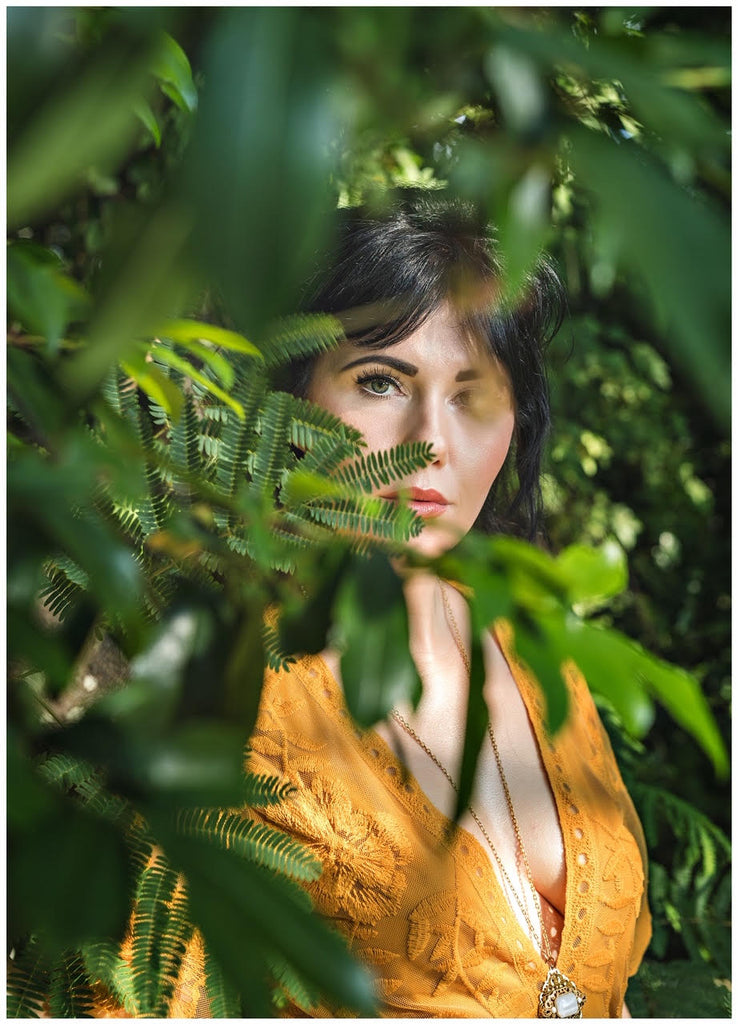 Tosha Gaines brunette woman in yellow dress green ferns