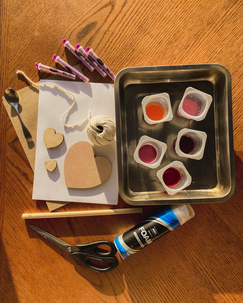 Everything you need for this DIY, paper, food colouring, shaving foam, twine and a wooden dowel