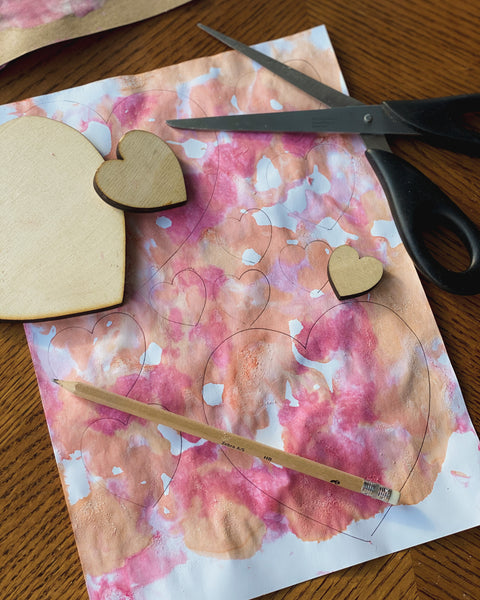 Once your dyed paper is dry, draw your hearts on to the paper