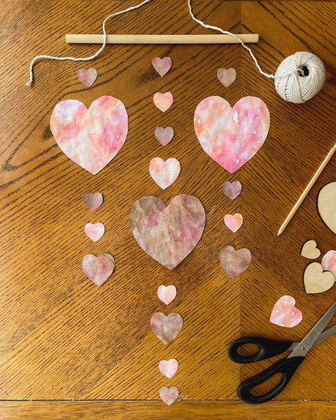 Plan out your heart design and cut your twine accordingly