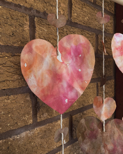 close up of the hand dyed heart paper for the Valentines day wall hanging