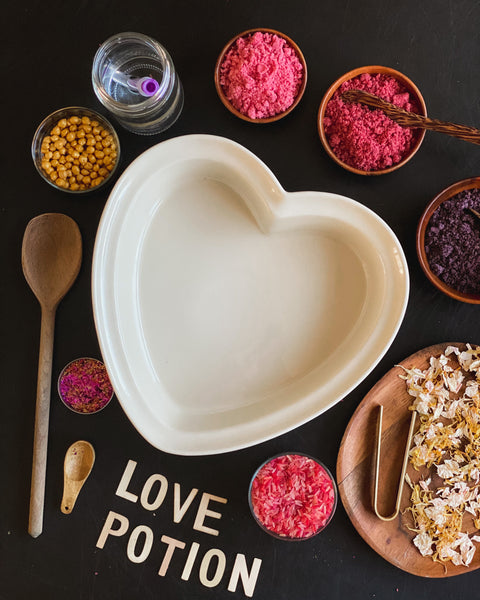 Ingredients for the love potion, potion powder, petals, chickpeas, rice and glitter