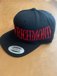 Black snap back hat with red writing