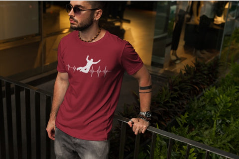 This red unisex t-shirt with white print is everything you have dreamed of and more. It feels soft and lightweight with the right amount of stretch. It is comfortable and flattering for both men and women and with heartbeat with a basejumper print on the front. Available in several colours.