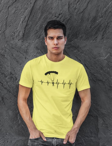 This yellow unisex t-shirt with black print is everything you have dreamed of and more. It feels soft and lightweight with the right amount of stretch. It is comfortable and flattering for both men and women and with heartbeat with a skydiver print on the front. Available in several colours.