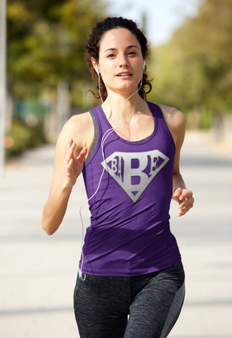 Purple with grey logo women's racer back vest with the BABE logo matching to the BASE range we have. It is made of sweat-wicking fabric and has elastic racerback with a curved hem and scoop neck. It has a very flattering cut for the female figure and will make sure to keep you cool, comfortable and moving freely during an active lifestyle.