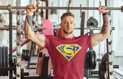 Red with blue and yellow logo super BASE sporty t-shirt designed with wicking fabric technology and mesh panels to give ventilated comfort during an active lifestyle. Mesh panels on reverse and under arms, crew neck and short raglan arms. This t-shirt is comfortable and has a flattering fit.