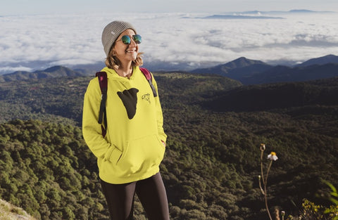 This yellow hoodie is soft, smooth and stylish. It is the perfect choice for the cooler evenings, the early morning jump of when you want a bit extra. It has soft cotton faced fabric, double fabric hood with self colour drawstring and front pouch pocket. It has a cliff and 'SEND IT' shaped as a jumper printed on front.