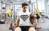 White with grey logo super BASE sporty t-shirt designed with wicking fabric technology and mesh panels to give ventilated comfort during an active lifestyle. Mesh panels on reverse and under arms, crew neck and short raglan arms. This t-shirt is comfortable and has a flattering fit.