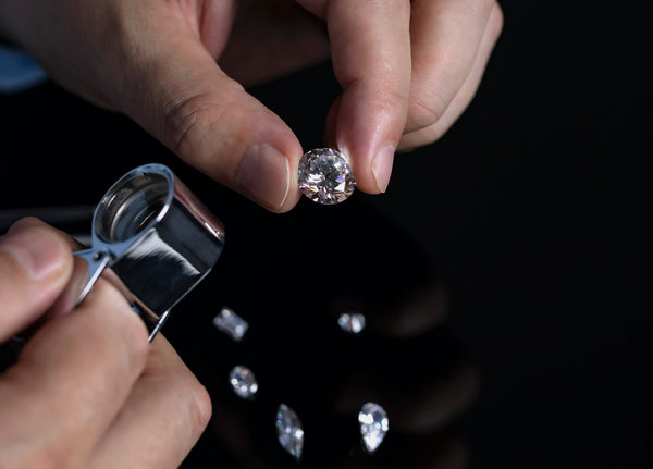 Inspecting lab grown diamond color under loupe