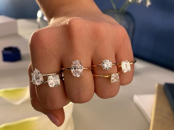 Stefano Navi diamond engagement rings being tried on