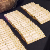 Gold and white wedding favors