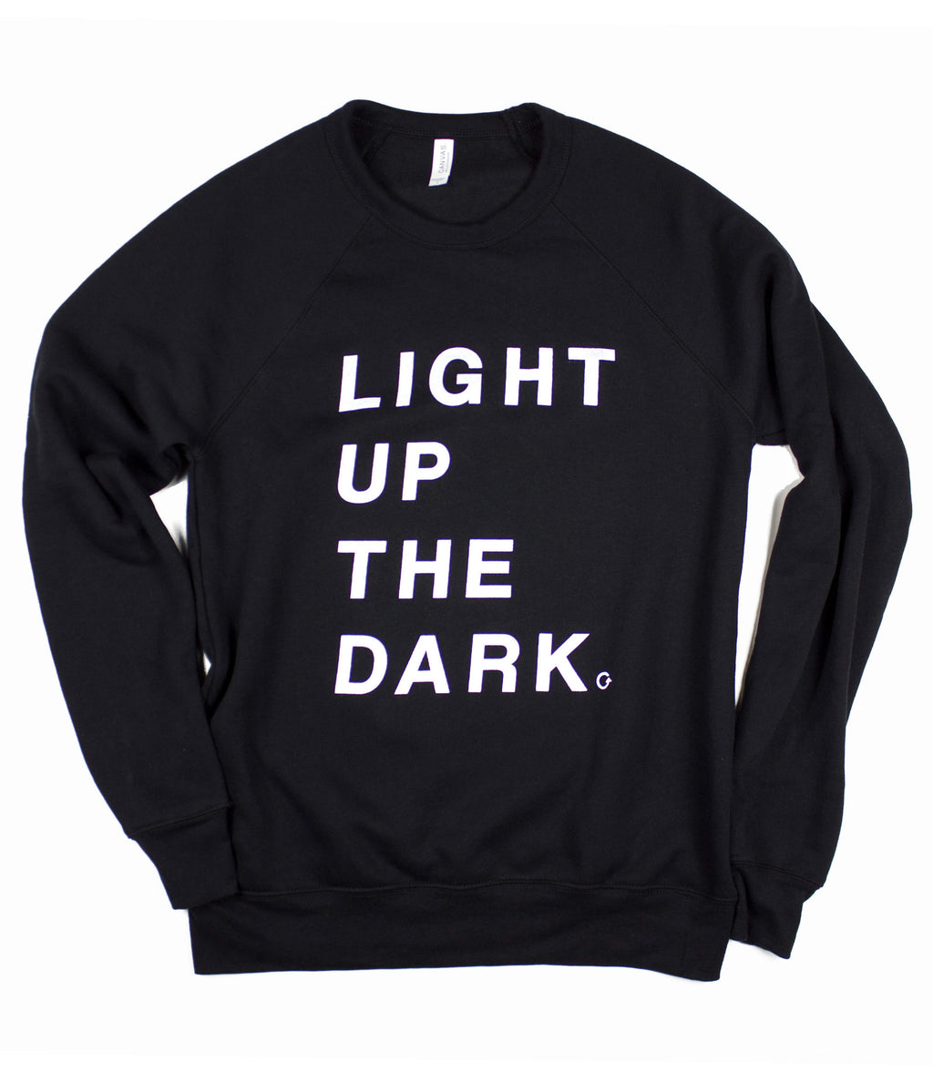 LIGHT UP THE DARK BLACK CREWNECK SWEATSHIRT