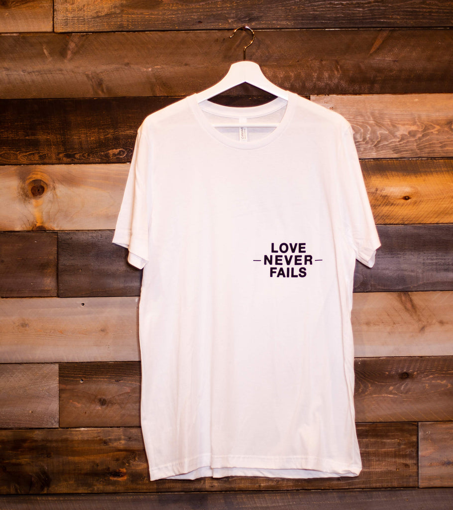 LOVE NEVER FAILS WHITE SLEEVE T-SHIRT