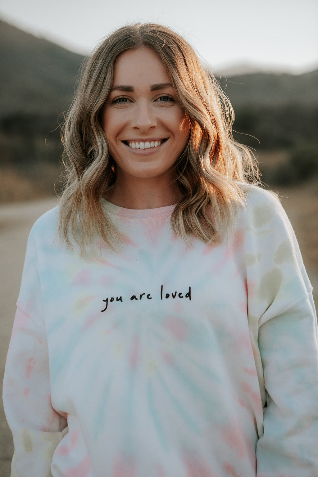 YOU ARE LOVED CURSIVE PASTEL TIE DYE PULLOVER SWEATSHIRT