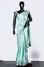 Paris Pale Green Linen Satin Saree And Blouse With Zari Appliques
