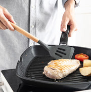 a person is cooking food on a grill