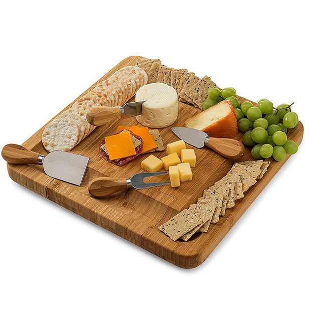 a cutting board with various fruits and vegetables