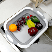 a plastic container filled with fruit and vegetables