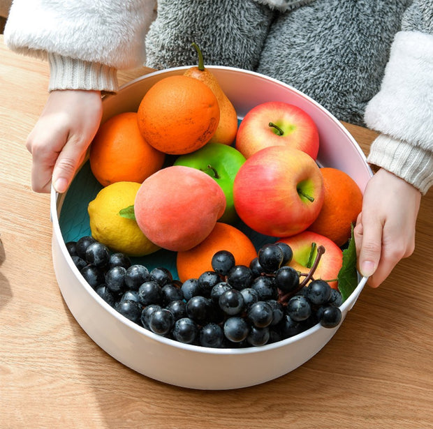 a bowl of fruits and vegetables on a table