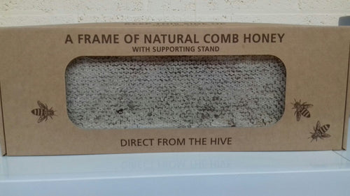 pure frame of honey with its own stand