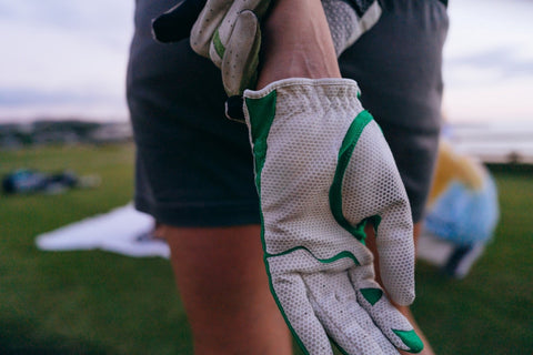 Zoomed-in view of a golf glove on a golfers hand