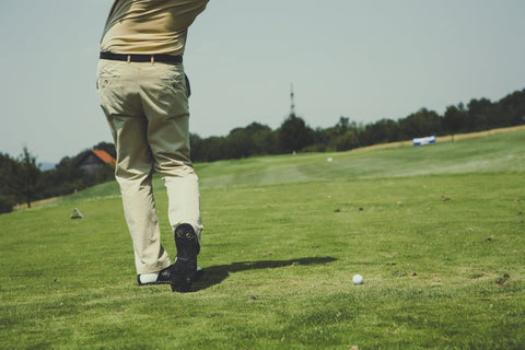 A golfer practicing their swing