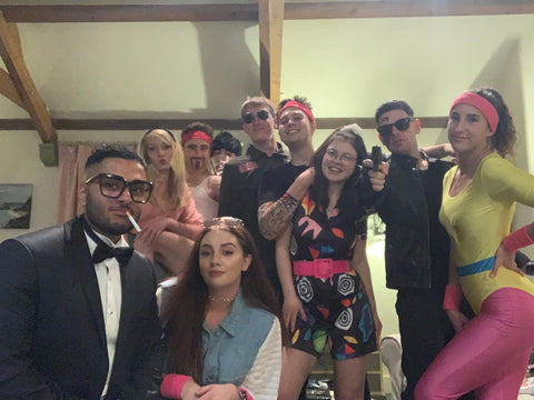 Small group 1980s themed murder mystery party