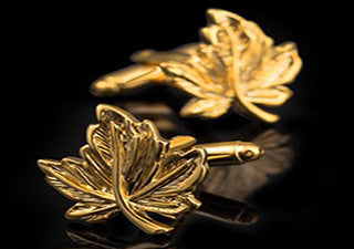 Gold maple leaf cufflinks