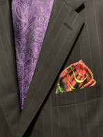 Folded pocket square with roulette wheel showing out of suit jacket breast pocket