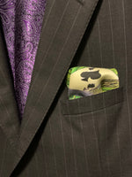 Folded pocket square with ace of spades showing out of suit jacket breast pocket