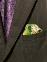 Folded pocket square with dice showing out of suit jacket breast pocket
