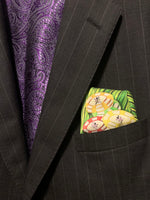 Folded pocket square with poker chips showing out of suit jacket breast pocket