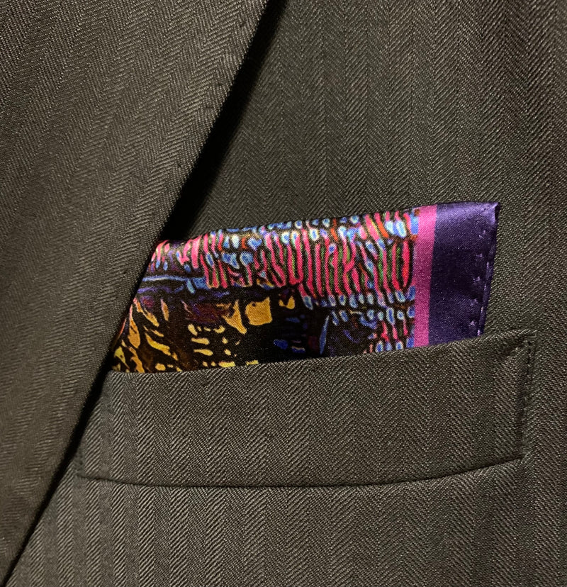 Silk pocket square with image of Montreal city skyline in shakes of indigo, pink, and gold