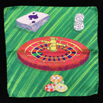 Pocket square with roulette wheel, deck of cards, dice and poker chips on a bright green background