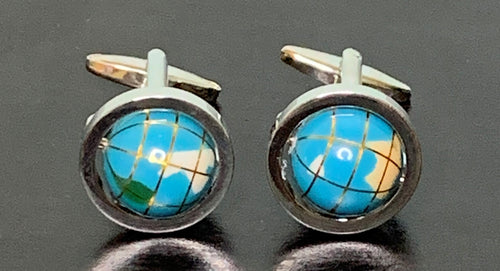 Light blue globe cufflinks with enamel continents in silver frame