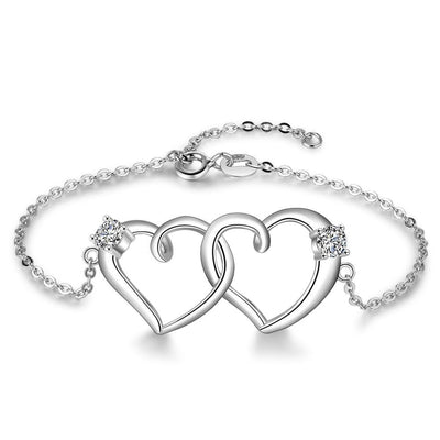 Intertwined Heart Silver Bracelet Jewelry at Jewels Genie