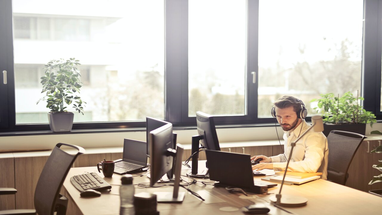 Customer Service specialist at a desk working